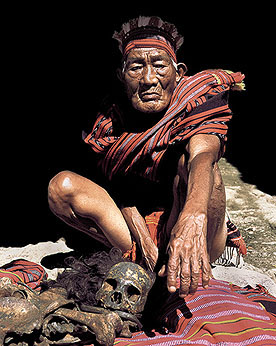 IFUGAO ELDER WITH BONES OF THIS FATHER