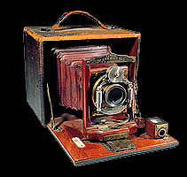 wood and brass antique camera